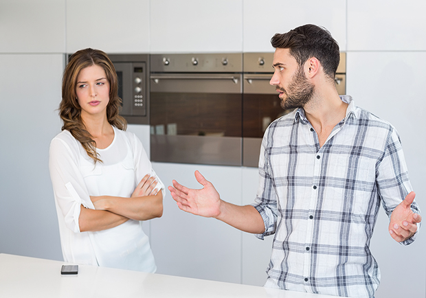 Improve your body language, man and woman in kitchen