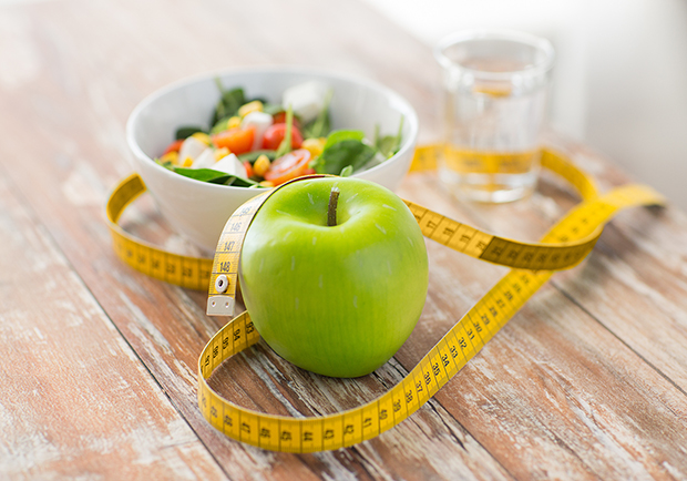 Shave 100 calories a day, apple, tape measure and water