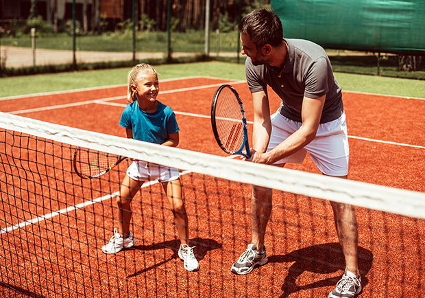 Dad and daughter playing tennis. Workouts to get you ready for summer