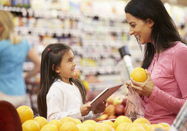 Mother and daughter grocery shopping, teach your child about positive body image