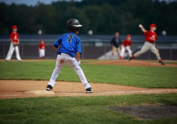 boy playing baseball, health tips for young athletes