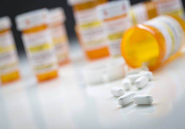 Pill bottles, Trying to Limit Prescription Opioid Misuse