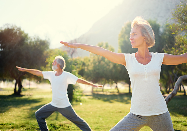 Seniors doing yoga in the park, way's to maintain balance as you age