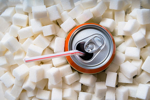 Don't drink your calories, soda surrounded by lot's of sugar cubes