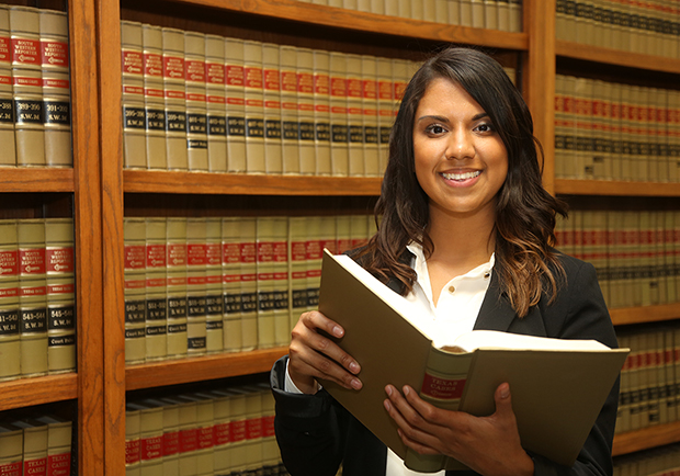 woman standing in front of law books, how I got into law school, large