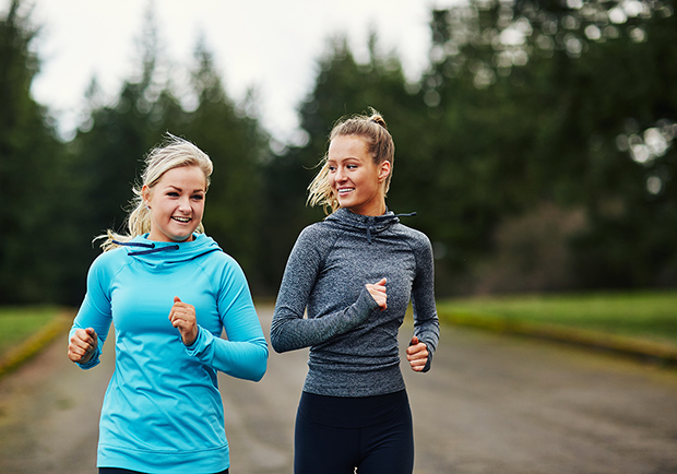 Two friends, ladies working out together. What are the benefits to having a workout buddy? Large
