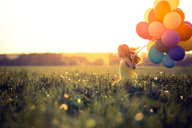Girl running with balloons, 7 ways to find happiness