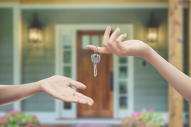 Handing over the keys to a new homeowner