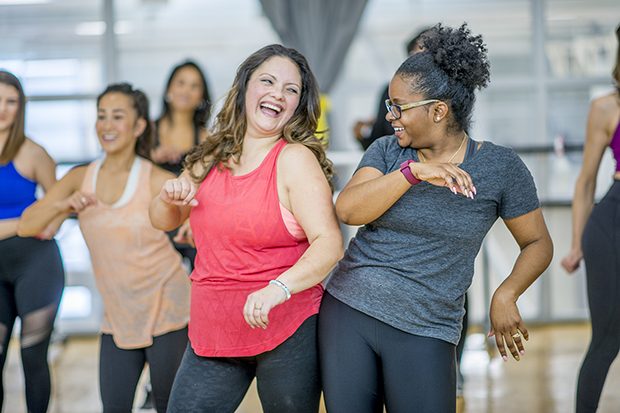 Women dancing exercising, helping improve body image lg