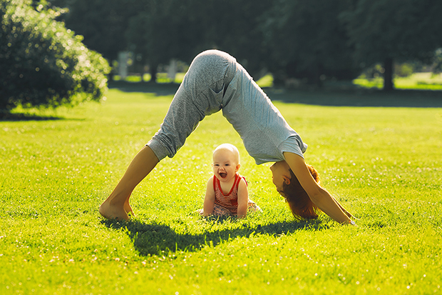 Mom and baby exercising outdoors, benefits