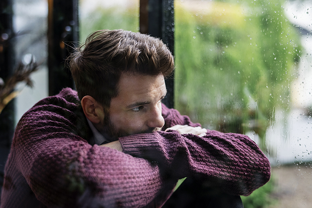 man staring out window, signs and symptoms of suicide lg