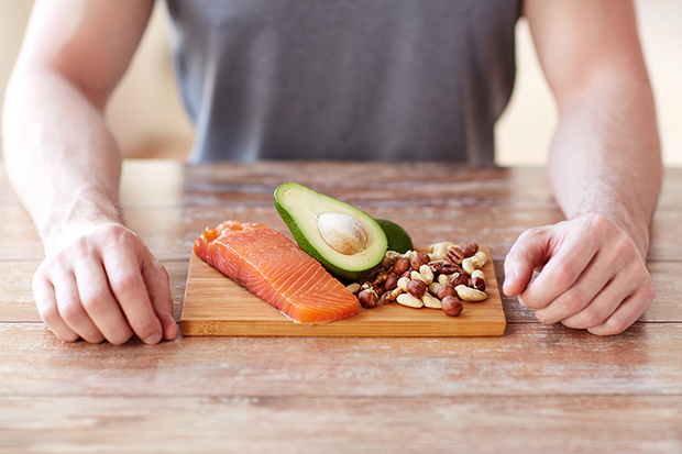 Man eating foods that build muscle lg