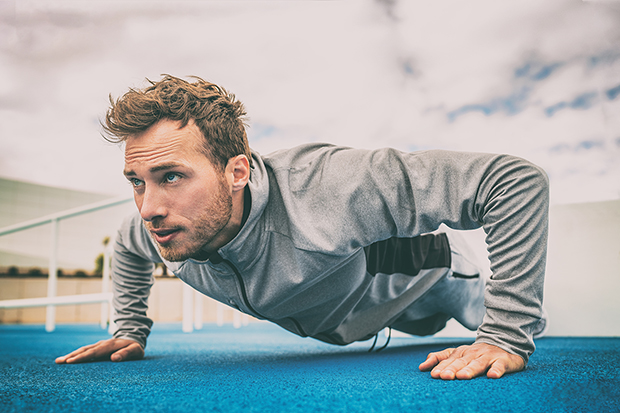A man recovering from a workout, push-up