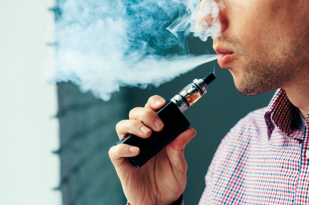 man vaping, is vaping healthier than smoking?