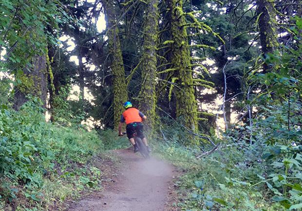 Staying safe while mountain biking in both Utah and Idaho. Man riding mountain bike.