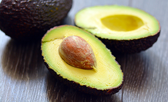 Avocados on a table, health benefits of avocados