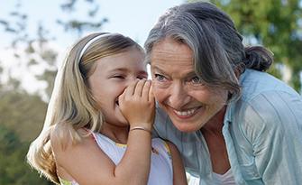 Grandmother and granddaughter telling a secret, Medicare basics