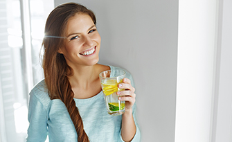 Woman holding water, avoiding dehydration, sm
