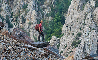 Man in the mountains, surviving. Here are some insurance survival tips.