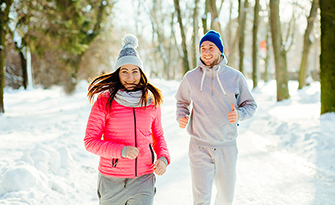 Man and woman running during the winter, ways to boost immunity in winter