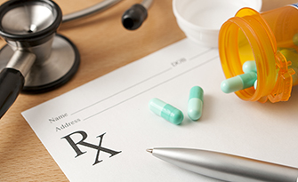Prescription and pills on a desk, pharmacy benefits