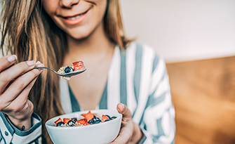 Woman-Eating_oatmeal-Developing-Healthy-Eating-Habits-sm