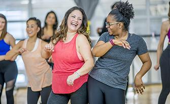 Women dancing exercising, helping improve body image sm