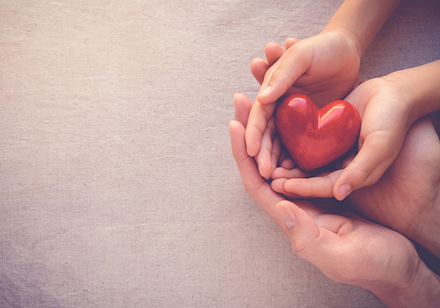 Hands holding a heart, random acts of kindness are great for mental health and overall wellness