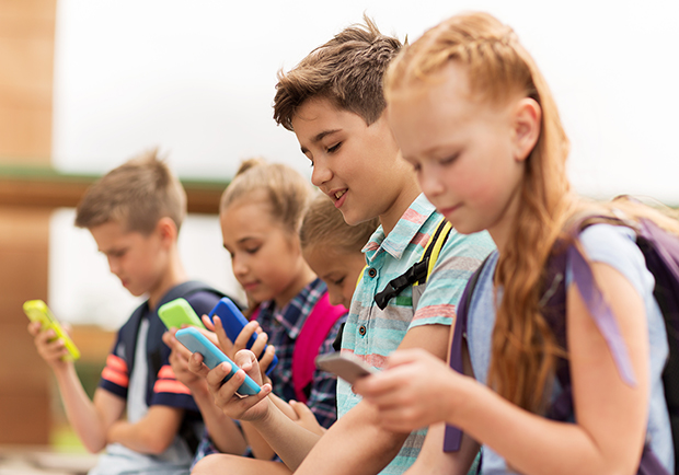 Kids playing with their phones, is your child ready for a smartphone?