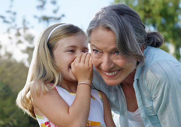 Grandmother and granddaughter telling a secret, Medicare basics