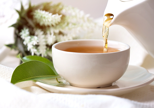 Pouring tea into a tea cup, there are many benefits to drinking tea
