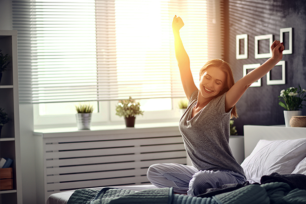 Woman waking up for a successful day