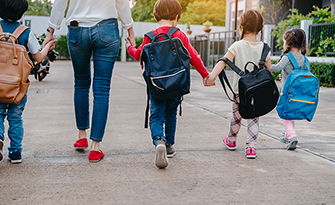 Mom with children taking them back to school sm