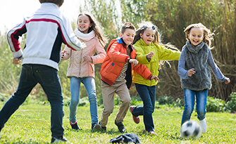 Children playing, reducing risk of childhood obesity sm