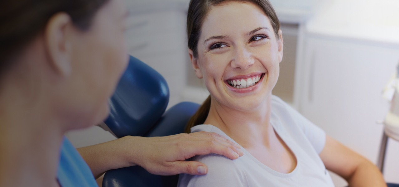 Patient looking at dental hygienist